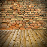 Pine floor and brick wall Royalty Free Stock Image
