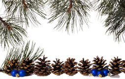 Pine Frame with Ornaments. Negative space framed with pine branches, pine cones and blue Christmas ornaments Royalty Free Stock Image