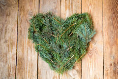 Pine heart on wood. En background Stock Photography
