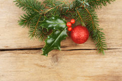 Pine and holly on wood Stock Photos