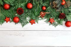 The Pine leaf with red star and christmas ball decoration on a w. The Pine leaf with red star and christmas ball decoration on white wooden board with copy space Royalty Free Stock Images