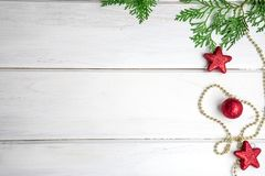 The Pine leaf with red star and christmas ball decoration on a w. The Pine leaf with red star and christmas ball decoration on white wooden board with copy space Royalty Free Stock Photos