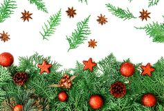 The  Pine leaf with red star and christmas ball decoration on wh. Pine leaf with red star and christmas ball decoration on white wooden board with copy space Royalty Free Stock Image