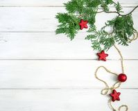 The Pine leaf with red star and christmas ball decoration on whi. Pine leaf with red star and christmas ball decoration on white wooden board with copy space Stock Image