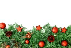 The  Pine leaf with red star and christmas ball decoration on wh. Pine leaf with red star and christmas ball decoration on white wooden board with copy space Royalty Free Stock Images