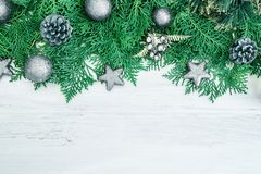 The Pine leaf with silver star and christmas ball decoration on. Pine leaf with silver star and christmas ball decoration on white wooden board with copy space Stock Images