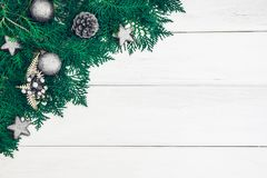 Pine leaf with silver star and christmas ball decoration on whit. E wooden board with copy space , happy new year and chistmas festival background concept Stock Photography
