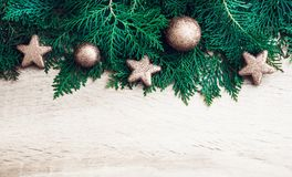 Pine leaf with silver star and christmas ball decoration on whit. E wooden board with copy space , happy new year and chistmas festival background concept Stock Image