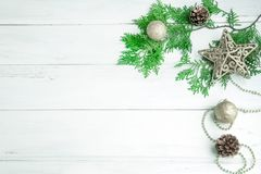 Pine leaf with silver star and christmas ball decoration on white wooden board with copy space , happy new year and chistmas festi. Val Stock Photo