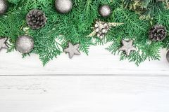 Pine leaf with silver star and christmas ball decoration on whit. The Pine leaf with silver star and christmas ball decoration on white wooden board with copy Stock Image