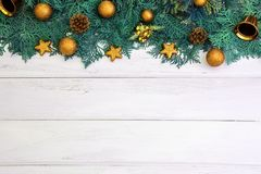 Pine leaf with yellow gold star and christmas ball decoration on. The Pine leaf with yellow gold star and christmas ball decoration on white wooden board with Stock Photography
