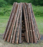 Pine logs are put in a pyramid for a traditional ritual pagan fi. Re. The holiday of the blossoming fern is celebrated in the Baltic countries in June Stock Photos
