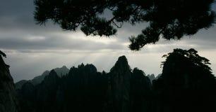 Pine mountain sunshine in huangshan. Chinas huangshan mountain in the morning sun Stock Photo