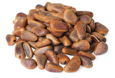 Pine nuts. On the white Stock Images