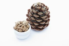 Pine nuts. Dried pineapple with pine nuts on a white background stock images