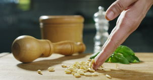 Pine nuts  and actions shoot in 6k resolution by professionals agency of food italian industries, and professionals chefs. stock footage