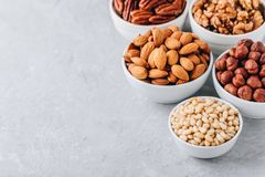 Free Pine Nuts, Almonds, Pecans, Walnuts And Hazelnuts In White Bowls On Grey Background. Mixed Nuts. Healthy Food And Snack. Stock Photos - 121066403