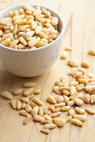 Pine nuts in bowl Royalty Free Stock Image