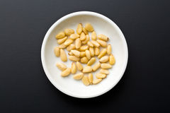Pine nuts in bowl Stock Photo