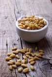 Pine nuts in a bowl Stock Photo