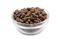 Pine nuts in a glass bowl Royalty Free Stock Photos