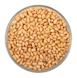 Pine nuts in glass plate Royalty Free Stock Image