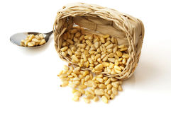 Pine nuts in a little  basket and on a spoon Royalty Free Stock Image