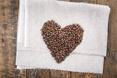 Pine nuts in the shell arranged in a heart shape stock photography