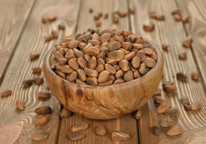 Pine nuts in a wooden bowl Stock Photos