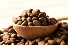 Pine nuts in a wooden spoon. Natural food. Selective focus.  stock photography