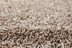 Pelllets. Pine pellets  - selective focus on foreground Stock Image