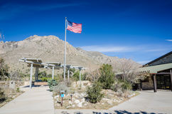 Pine Springs Visitor Center - Guadalupe Mountains National Park. Flag waving in the air in front of Guadalupe Mountains at Visitor Center, the first stop in Stock Photos