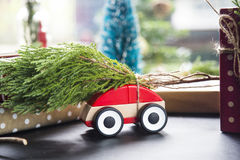Pine on toy car for christmas. Royalty Free Stock Image