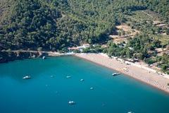 Pine tree with blue sea laguna paraglaiding background Turkey Royalty Free Stock Photos