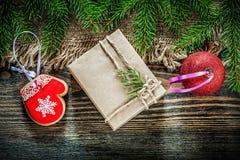 Pine tree branch bagging Christmas ball gingerbread gift box on Stock Photography