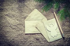 Pine tree branch envelope paper pencil angel on sacking backgrou. Nd Royalty Free Stock Image