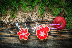 Pine tree branches bagging Christmas ball gingerbread on wood bo Royalty Free Stock Image