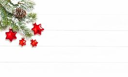Pine tree branches red stars Christmas decoration. Pine tree branches with red stars Christmas decoration royalty free stock photo