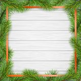 Pine tree branches square frame on white wooden background. Christmas tree branches like square frame on white wooden planks background. Template for Christmas Royalty Free Stock Image