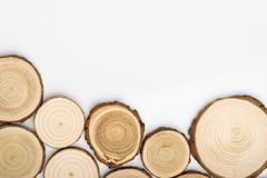 Pine tree cross-sections with annual rings on white background. Lumber piece close-up, top view. Pine tree cross-sections with annual rings on white background stock photos