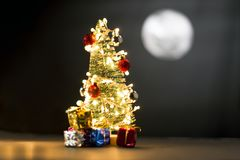 Pine tree with fancy lights and full moon stock photos