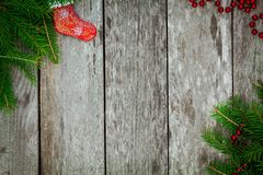 Pine tree with red sock and garland on old wooden background Stock Images