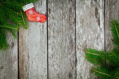 Pine tree  red sock on old wooden background Royalty Free Stock Photos