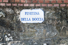 Pine tree sign old stone wall and bricks in Vinci,italy Stock Photos