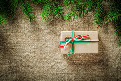 Pine tree twig handmade present box on bagging surface Stock Images