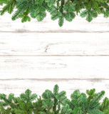 Pine Tree Twigs On Wooden Background. Winter Holidays Royalty Free Stock Image