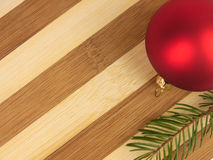 Pine trees and christmas ball on a chopping board Royalty Free Stock Photography