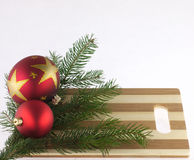 Pine trees and christmas ball on a chopping board Stock Photos