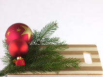 Pine trees and christmas ball on a chopping board Stock Photography