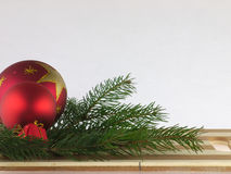 Pine trees and christmas ball on a chopping board Royalty Free Stock Images